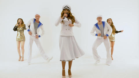 Girl-singer in the captain's dress. Two young men in suits of sailors. Two Live Action