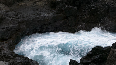Big waves crashing on cliff of lava rocks Footage