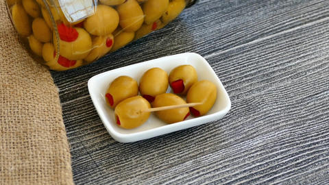 green olives, green olives stuffed with red pepper inside green olives stuffed Live Action