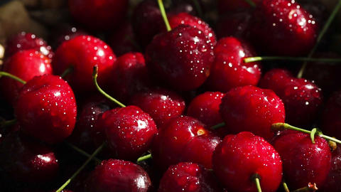 red cherries rotate in basket Live Action