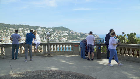 People standing on observation deck admiring great view of Nice infrastructure Footage