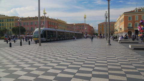 Passengers running along Place Massena to bus stop to get on speed tramcar Footage