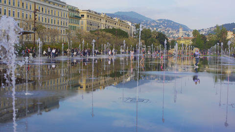Cool trickles of water from mirror fountain refreshing and amusing passers-by Footage