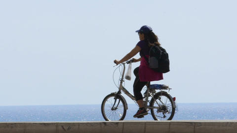 Woman cycling at Nice embankment, tourism and sport, active lifestyle. Slow-mo Footage