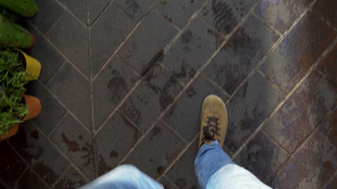 Tired mans legs slowly walking home after work along city street, point of view Footage