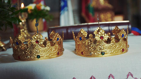 Gold crowns are on the altar. Attributes of priest Live Action
