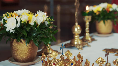 Church attributes for wedding ceremony. Gold crowns in church Footage
