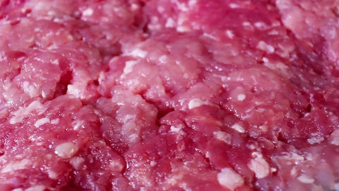 Minced meat pig pork meat rotating food texture closeup video footage. Studio Live Action
