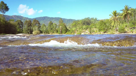 river flows stream fast against pictorial landscape GIF