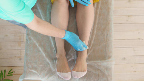 Close-up of hair removal master removes leg hair using shugaring top view Footage