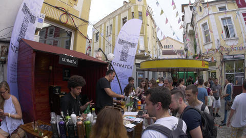 Preparing cocktails during street festival in European city GIF