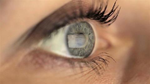 Woman girl macro eye looking monitor, searching Internet google Footage