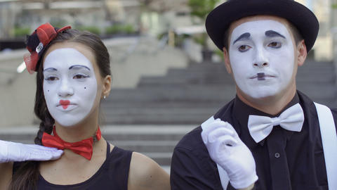 Young people mimes playing their expressions on camera Footage