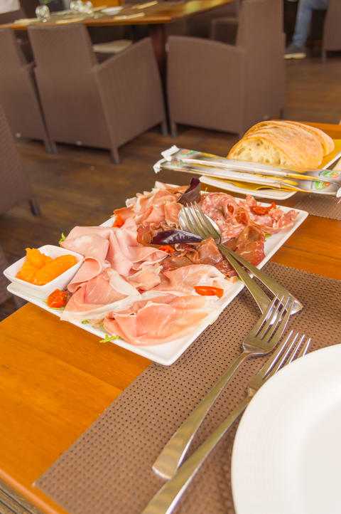 Plate of hams and smoked sausages Photo