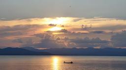 Sunset over fishing boats on reservoir, Thailand ビデオ