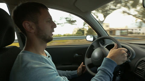 Happy male resident going about his business confidently turning steering wheel Footage