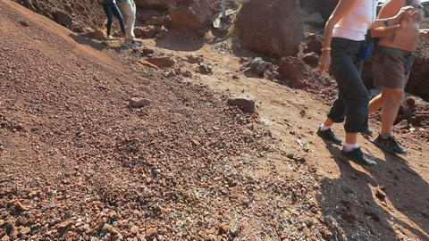 Many tourists walking along dangerous slope of volcanic origin mountains Live Action