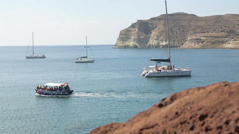 Many pleasure yachts and trimarans moored near shore, people enjoying weekend Footage