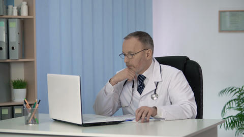 Male doctor familiarizing with innovations and discoveries in medicine online Footage