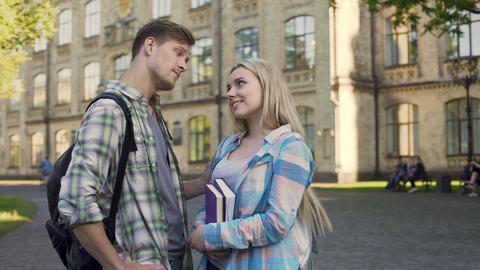 Handsome young man flirting with pretty blonde near college, students, meeting Footage