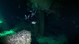 Scuba diving underwater in caves of Yucatan Mexico cenotes Footage