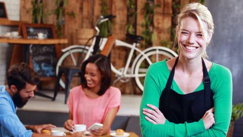 Portrait of smiling waitress Footage