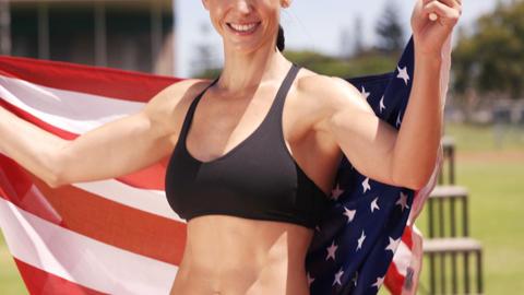 Sportswoman holding American flag Footage