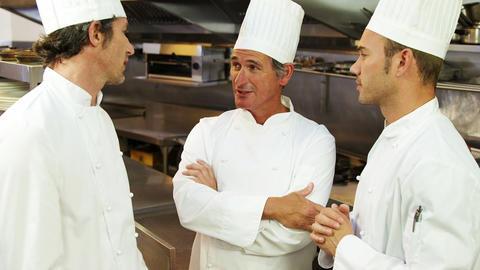 Handsome chef having a conversation Footage
