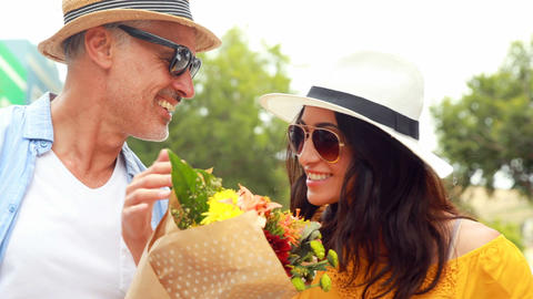 Smiling couple with flowers Footage