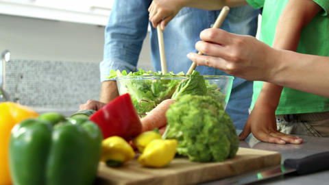 Cute family preparing a salad Footage
