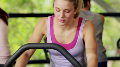 Fit woman doing exercise bike Footage