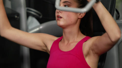 Fit woman using weight machine Footage