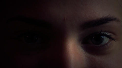 The Girl's Eyes In A Dark Room Close Up 5 stock footage