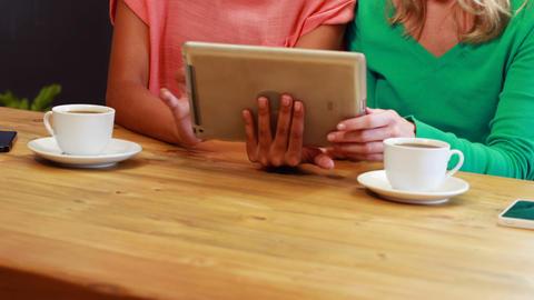 Surprised friends looking at tablet Stock Video Footage