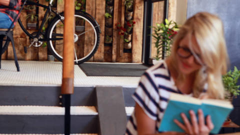 Hipster woman reading a book Live Action