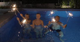 Celebration with sparklers in the swimming pool Footage