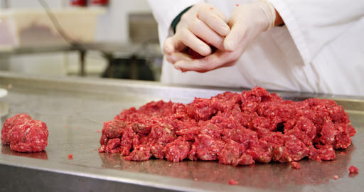 Mid section of butcher preparing meat ball from minced meat Live Action