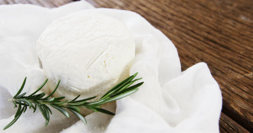 Cheese with rosemary herb Live Action
