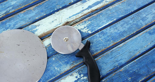 Pizza peel and cutter on wooden table Live Action