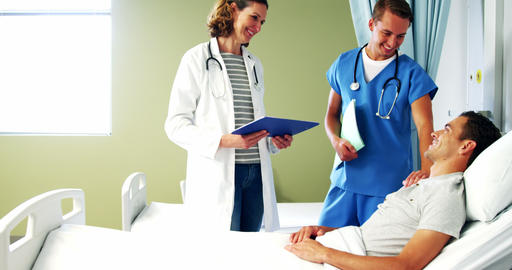 Doctor and nurse interacting with patient Footage