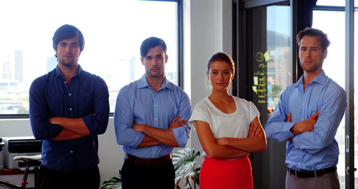 Confident business executives standing with arms crossed in office Footage