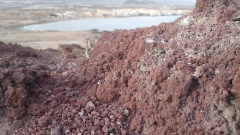 Volcanic rocks in desert environment beside the ocean in the south of Tenerif Live Action