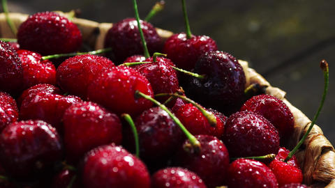 Fresh cherry with water drops on dark background. Fresh... Stock Video Footage