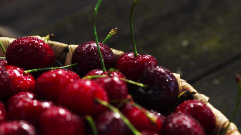 Fresh cherry with water drops on dark background. Fresh… Stock Video Footage