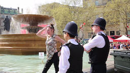Drunk lady in Trafalgar Square fountains watched by policemen UK GIF