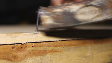 Skillful carpenter correcting beginner's work on nailing of wooden box, workshop Footage