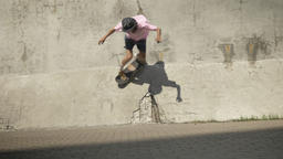 Stylish skateboarder doing skateboard trick on old wall Footage
