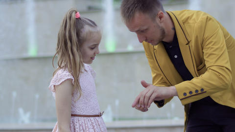 Magician show trick with coin to a little girl Footage