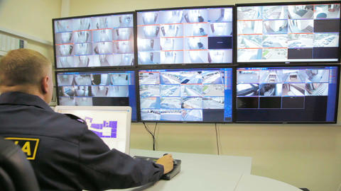 security officer in control center with monitors Footage