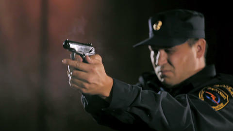 officer takes out handgun and shoots in range Footage